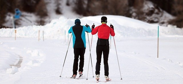 A person is cross country skiing in the snow